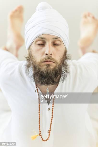 Man practicing Kundalini yoga and Bow pose