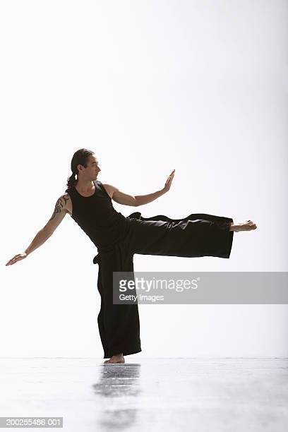 Man practicing martial arts kick