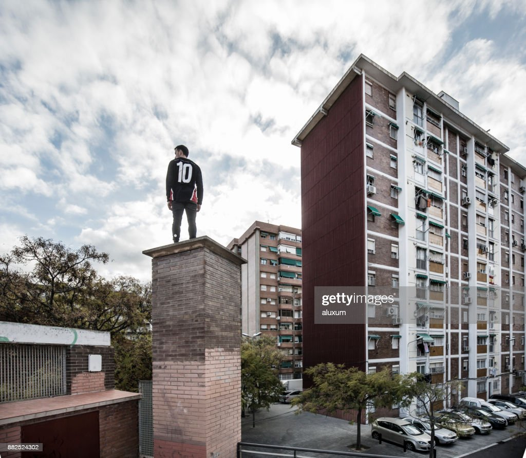 Man practicing parkour in city suburbia : Stock Photo