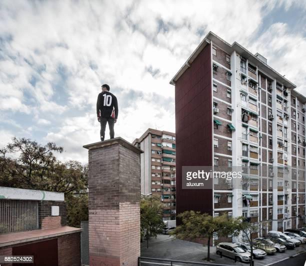 man practicing parkour in city suburbia - cornella de llobregat stock pictures, royalty-free photos & images