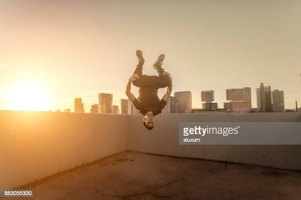 man practicing parkour in the city of barcelona catalonia spain - upside down stock pictures, royalty-free photos & images