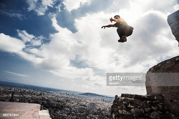 Man practicing parkour in the city of Barcelona