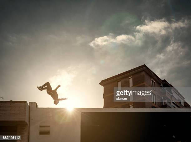 man practicing parkour in the city - free running stock pictures, royalty-free photos & images