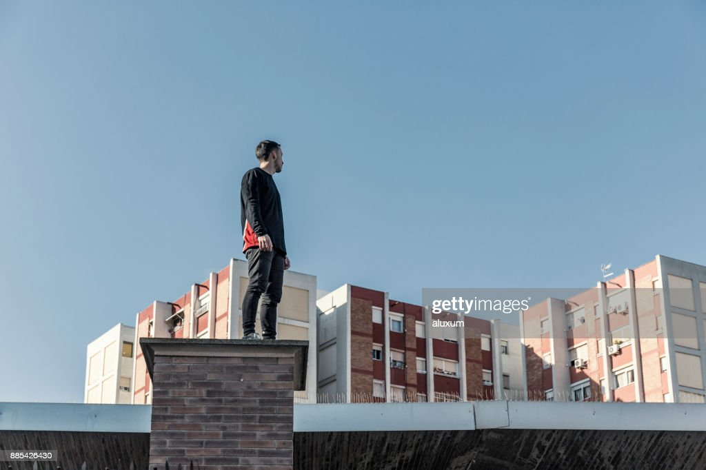Man practicing parkour in the city : Stock Photo