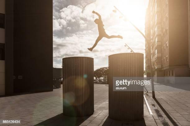 man practicing parkour in the city - cornella de llobregat stock pictures, royalty-free photos & images