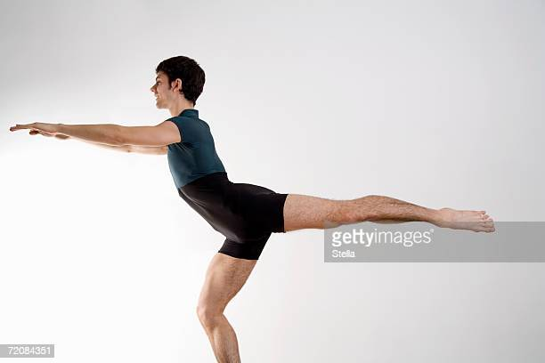man practicing pilates - dansstudio stock pictures, royalty-free photos & images