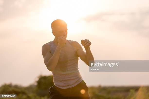 Man practicing shadow boxing outdoors