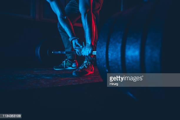 man practicing weightlifting - weight training stock pictures, royalty-free photos & images