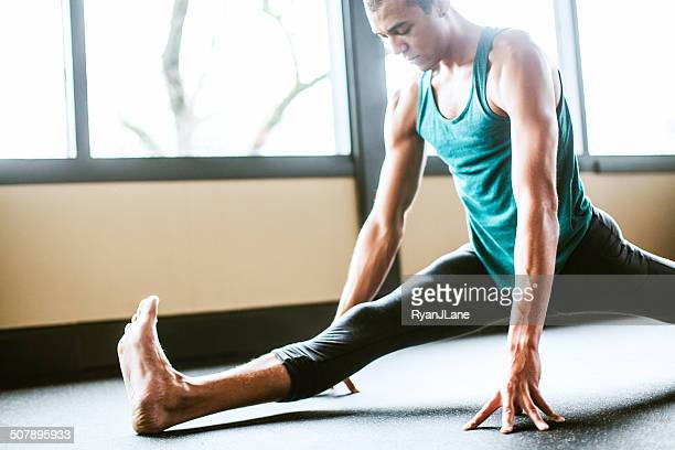 Man Practicing Yoga in Bright Studio