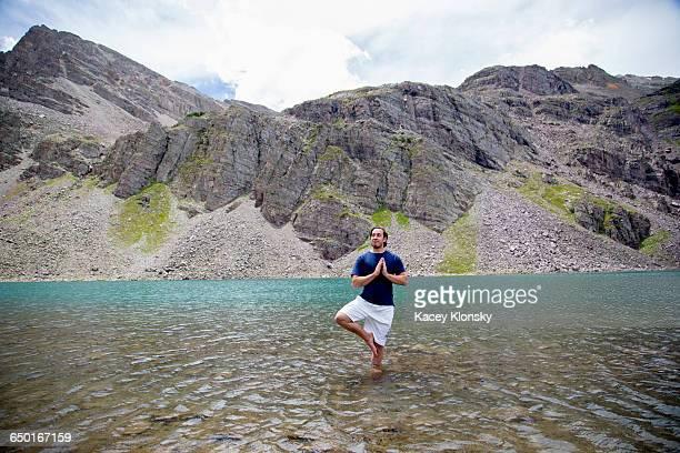 Man practising yoga, Cathedral Lake, Aspen, Colorado