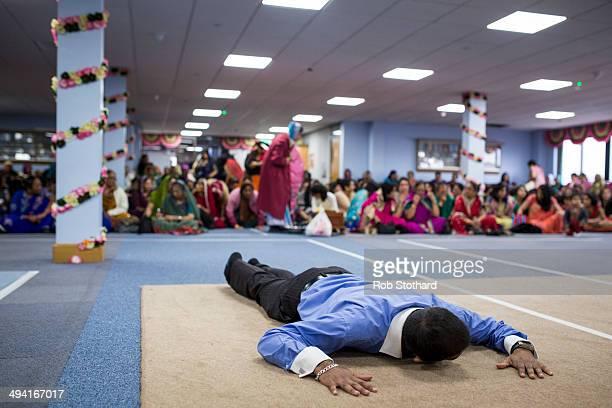 A man prayers in the temporary prayer hall at the Shree Swaminarayan Mandir a major new Hindu temple being built in Kingsbury before a visit by Mayor...