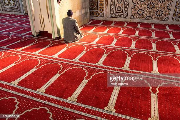 man praying, al-husseiny mosque, amman, jordan - jordanian workforce stock pictures, royalty-free photos & images