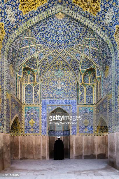 man praying at ornate shrine - isfahan ストックフォトと画像