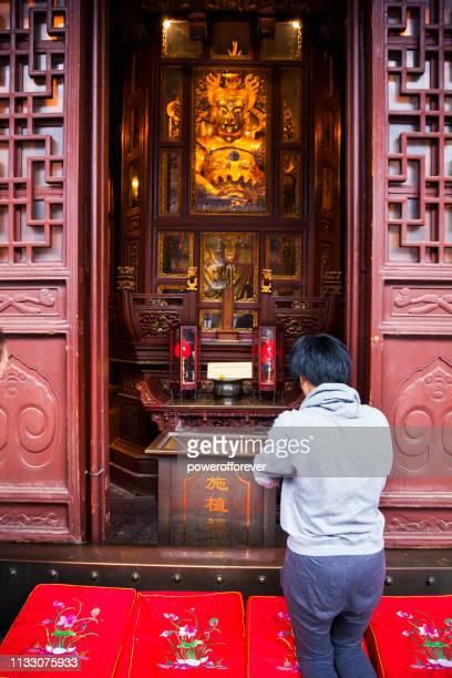Man Praying at the Jade Buddha Temple in Shanghai, China