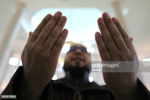 Man praying in a mosque. France.
