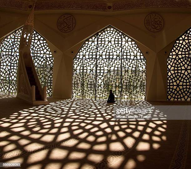 man praying in mosque - mosque stock pictures, royalty-free photos & images