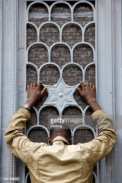 Man praying outside Beta Maryam church