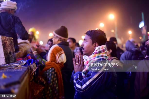 a man praying to kapil muni temple during ganga sagar fair - ganga sagar stock photos and pictures