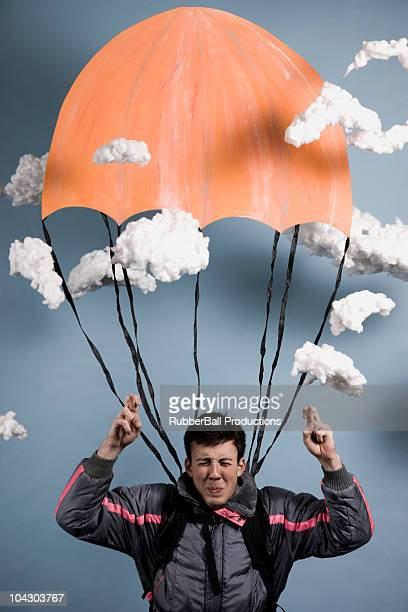 man praying while parachuting