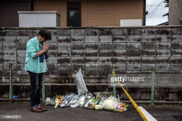 Man prays after laying flowers near the Kyoto Animation Co studio building after an arson attack, on July 19, 2019 in Kyoto, Japan. Thirty three...