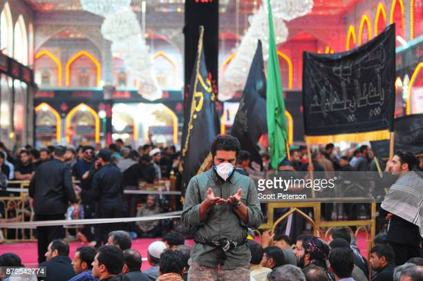 A man prays as Shiite pilgrims reach the climax of days of marching inside the shrine of Imam Hossein to commemorate arbaeen the fortieth day after...