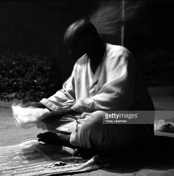 A man prays at home for the Magal De Touba April 22 2003 in Mbake Senegal The Mouride Baye Fall community in Senegal celebrates the Magal De Touba in...
