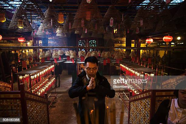 A man prays at Man Mo Temple in Hong Kong China on Thursday Feb 4 2016 The city's financial markets will close on Feb 8 for the Lunar New Year...
