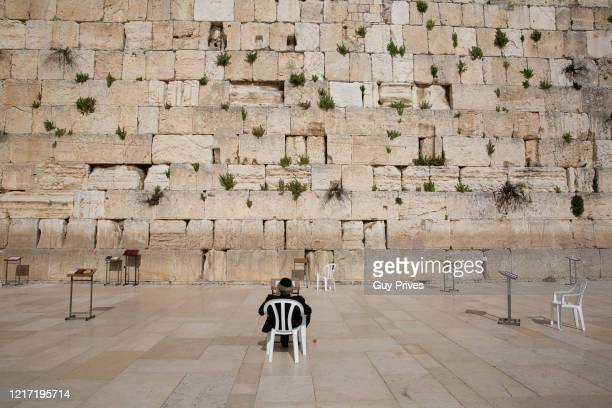 Man prays at the empty Western Wall in the old city during a government enforced lockdown due to the coronavirus on April 06, 2020 in Jerusalem,...