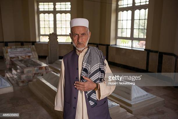 A man prays at the Shah Agha shrine September 4 2015 before attending the traditional Friday prayers in Kabul Afghanistan