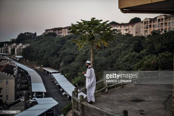 A man prays before breaking his fast during an Iftar at the Sufi Bhaijaan Darbaar Mosque in Durban on May 7 2019 on the evening of the first day of...