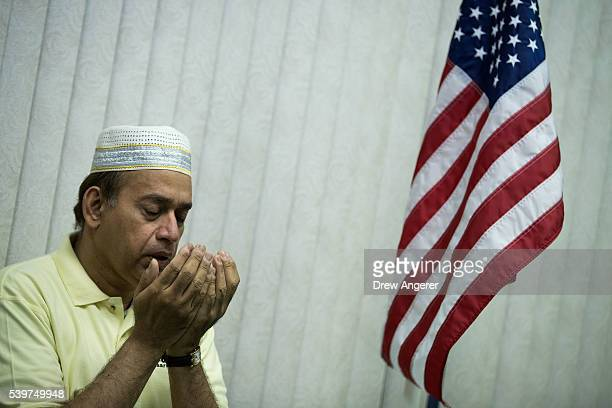 A man prays during a prayer service at the BaitulAafiyatr Mosque June 12 2016 in Orlando Florida The shooting at Pulse Nightclub which killed 50...