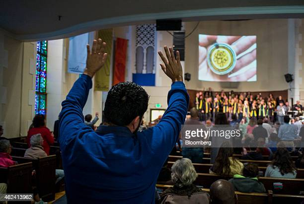 A man prays during a Sunday service at the Glide Memorial Church in the Tenderloin district of San Francisco California US on Sunday Jan 18 2015 In a...