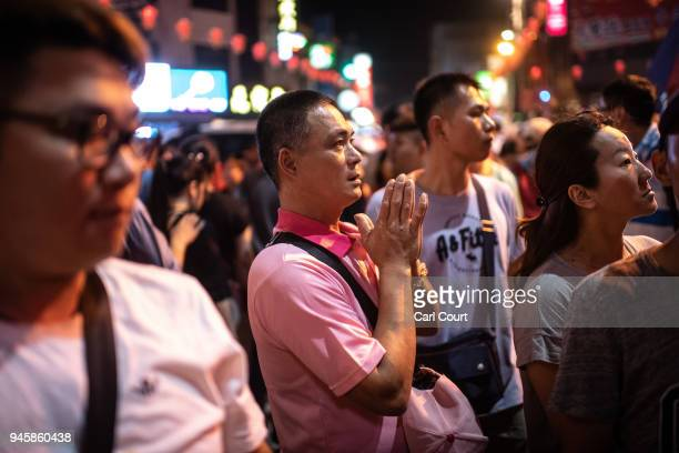 A man prays during festivities to mark the beginning of the nine day Mazu pilgrimage on April 13 2018 in Dajia near Taichung Taiwan The annual Dajia...
