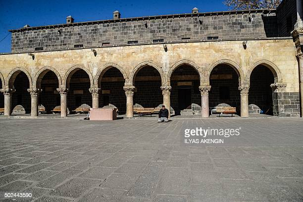 A man prays during Friday noon prayers at the Ulu Mosque built in 1091 by the Seljuk ruler MalikShah as a military curfew is lifted on December 25...
