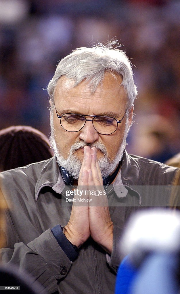 A man prays during the invitation 'to accept Jesus Christ' at the last mission to California for America's best known evangelist, 84-year-old Billy Graham, on May 8, 2003 to San Diego, California. Some 54,000 people attended tonight's service which is expected to total 200,000 over the four-night event as thousands convert to Christianity.