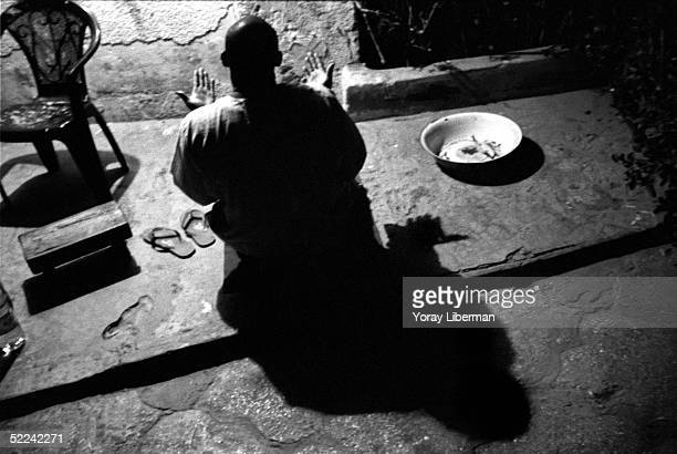A man prays during the Magal De Touba April 21 2003 in Mbake Senegal The Mouride Baye Fall community in Senegal celebrates the Magal De Touba in...