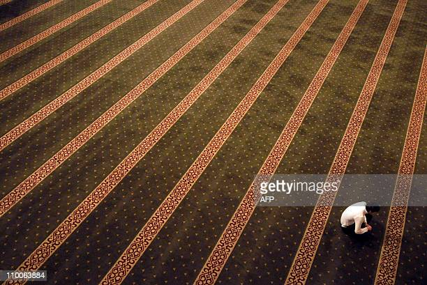 A man prays early on March 10 2011 in the Heart of Chechnya mosque dedicated to late Chechen President Ahmad Kadyrov father of the current leader...
