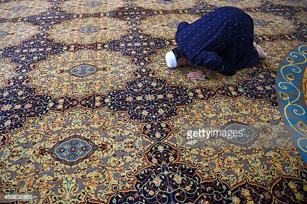 A man prays for murdered aid worker Alan Henning in Manchester Central Mosque in Manchester north west England on October 4 2014 Britain reacted with...