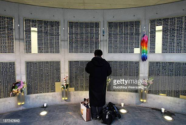 A man prays for the victims of the Kobe Great Earthquake during a memorial ceremony to commemorate the 17th anniversary of the 1995 Great Hanshin...