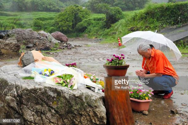 A man prays for the victims where three people were killed on the first anniversary of the torrential rain diaster on July 5 2018 in Asakura Fukuoka...