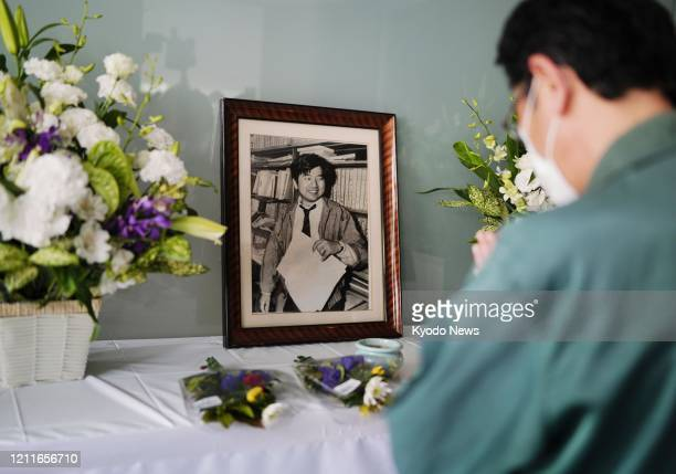 A man prays in front of an altar set up at a bureau of The Asahi Shimbun newspaper in Nishinomiya Hyogo Prefecture western Japan on May 3 in memory...