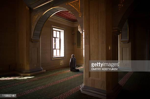 A man prays inside Grozny's main mosque on March 7 2011 AFP PHOTO / DMITRY KOSTYUKOV