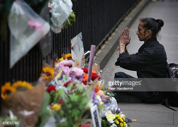 A man prays near a memorial to the victims of the July 2005 bus bombing near Tavistock Square on July 7 2015 in London England Today is the tenth...