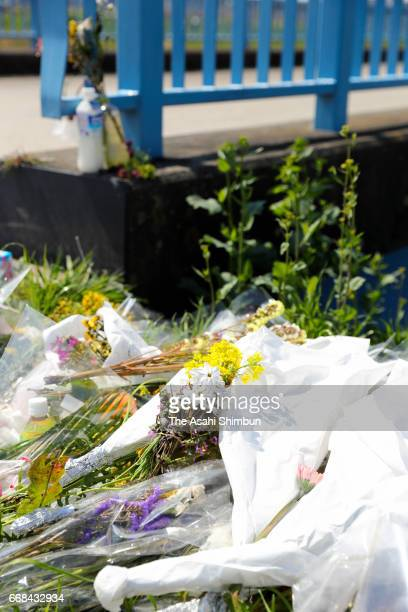 Man prays near the area where the body of a 9-year-old Vietnamese girl Le Thi Nhat Linh was found after suspect Yasumasa Shibuya was arrested on...