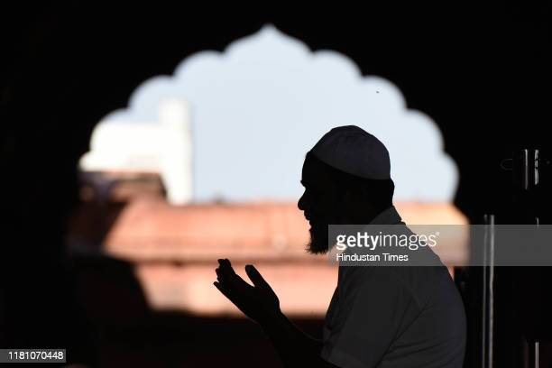 A man prays on the day of the Supreme Court verdict in the Ram Janmabhoomi Babri Masjid case on November 8 2019 in New Delhi India Supreme Court to...