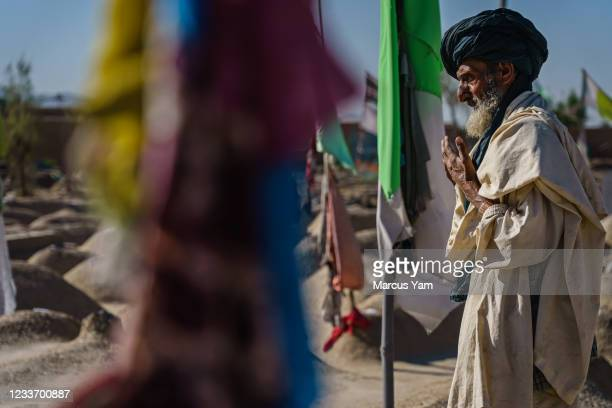 Man prays over the Arab shrine, for the scores of Arab Al Qaeda fighters and their families, all killed in the waning days of 2001 when America first...