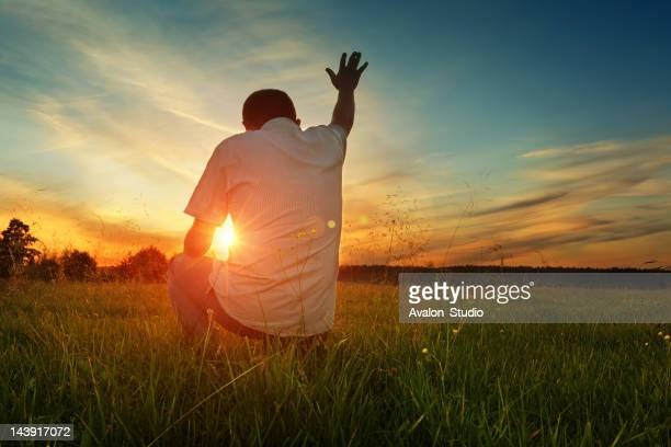 man prays to god - christendom stockfoto's en -beelden