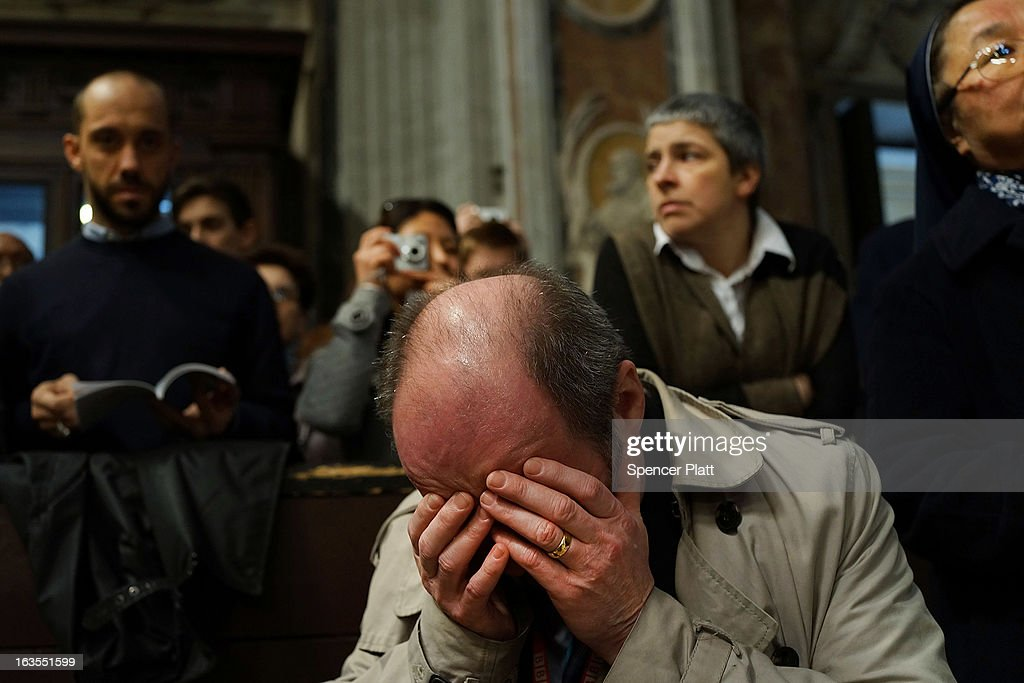 A man prays while attending the Pro Eligendo Romano Pontifice Mass at St Peter's Basilica, after which Cardinals will enter the conclave to decide who the next pope will be on March 12, 2013 in Vatican City, Vatican. Cardinals are set to enter the conclave to elect a successor to Pope Benedict XVI after he became the first pope in 600 years to resign from the role. The conclave is scheduled to start on March 12 inside the Sistine Chapel and will be attended by 115 cardinals as they vote to select the 266th Pope of the Catholic Church.