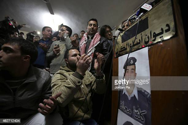 Man prays with verses of Quran for the soul of captured Jordanian pilot Muath Al Kasasbeh after hearing the news of his execution at the Kasasbeh...