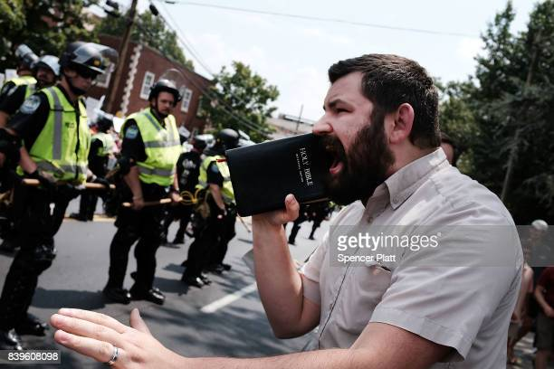 A man preaches as supporters for and against a Fort Sanders Confederate memorial monument face off in on August 26 2017 in Knoxville Tennessee The...